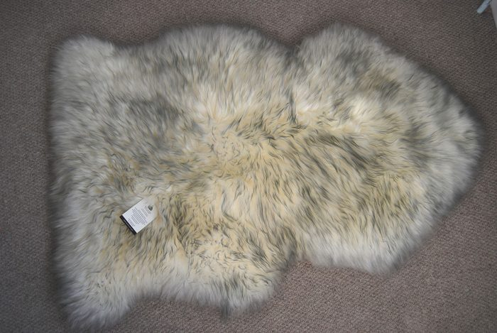 Ivory Grey Tipped Sheepskin Rug on Floor
