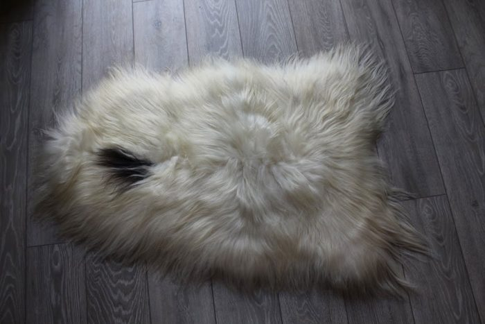 Natural Icelandic Sheepskin with Black Spot on Floor